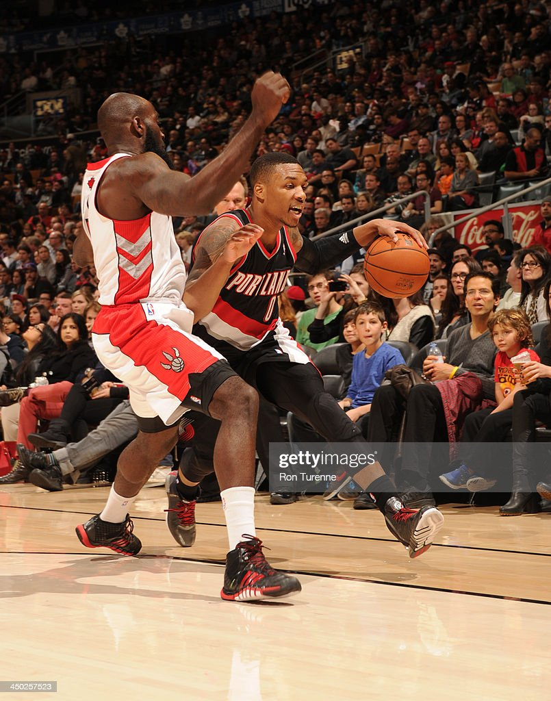 <a gi-track='captionPersonalityLinkClicked' href=/galleries/search?phrase=Damian+Lillard&family=editorial&specificpeople=6598327 ng-click='$event.stopPropagation()'>Damian Lillard</a> #0 of the Toronto Raptors dribbles baseline against the Portland Trail Blazers during the game on November 17, 2013 at the Air Canada Centre in Toronto, Ontario, Canada.