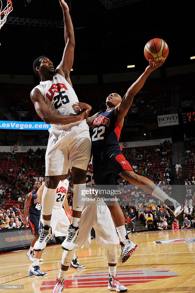 Damian Lillard #22 of the USA Blue Team attempts a shot against Andre Drummond #25 of the USA White Team during the 2013 USA Basketball Showcase at the Thomas and Mack Center on July 25, 2013 in Las Vegas, Nevada.