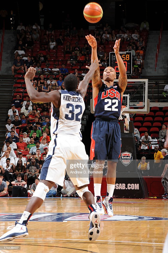 Damian Lillard #22 of the USA Blue Team attempts a shot against Michael Kidd-Gilchrist #32 of the USA White Team during the 2013 USA Basketball Showcase at the Thomas and Mack Center on July 25, 2013 in Las Vegas, Nevada.