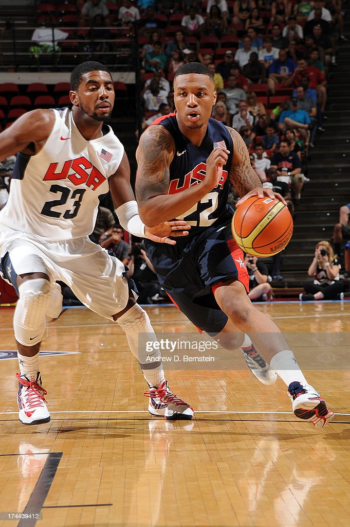 Damian Lillard #22 of the USA Blue Team drives to the basket against Kyrie Irving #23 of the USA White Team during the 2013 USA Basketball Showcase at the Thomas and Mack Center on July 25, 2013 in Las Vegas, Nevada.