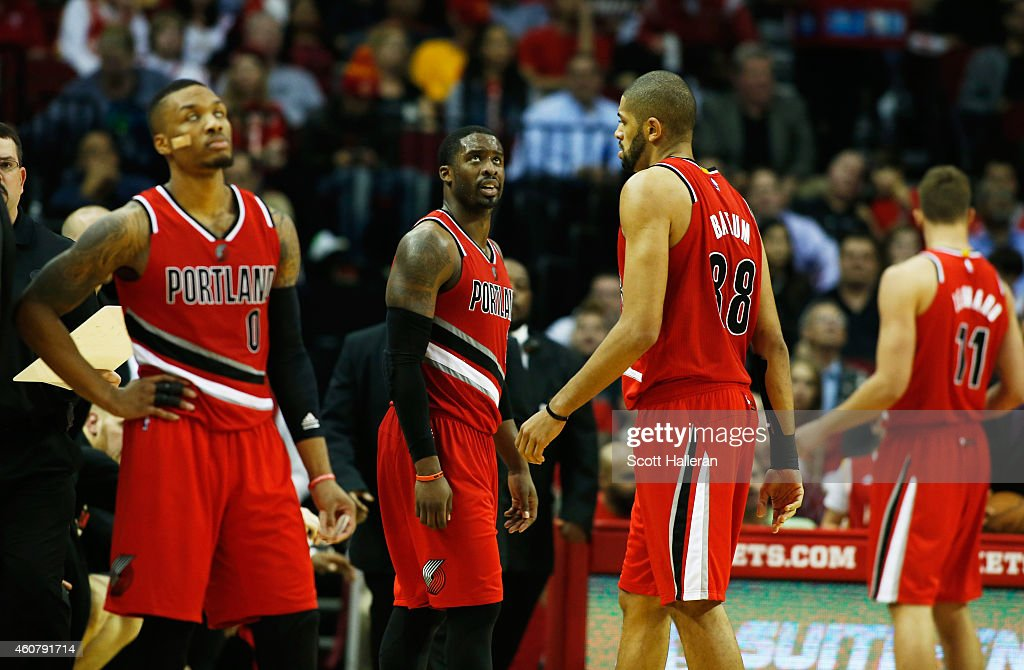 <a gi-track='captionPersonalityLinkClicked' href=/galleries/search?phrase=Damian+Lillard&family=editorial&specificpeople=6598327 ng-click='$event.stopPropagation()'>Damian Lillard</a>, <a gi-track='captionPersonalityLinkClicked' href=/galleries/search?phrase=Wesley+Matthews&family=editorial&specificpeople=804816 ng-click='$event.stopPropagation()'>Wesley Matthews</a>, <a gi-track='captionPersonalityLinkClicked' href=/galleries/search?phrase=Nicolas+Batum&family=editorial&specificpeople=3746275 ng-click='$event.stopPropagation()'>Nicolas Batum</a> and <a gi-track='captionPersonalityLinkClicked' href=/galleries/search?phrase=Meyers+Leonard&family=editorial&specificpeople=6893999 ng-click='$event.stopPropagation()'>Meyers Leonard</a> of the Portland Trail Blazers wait on the court as a play is reviewed during their game against the Houston Rockets at the Toyota Center on December 22, 2014 in Houston, Texas.