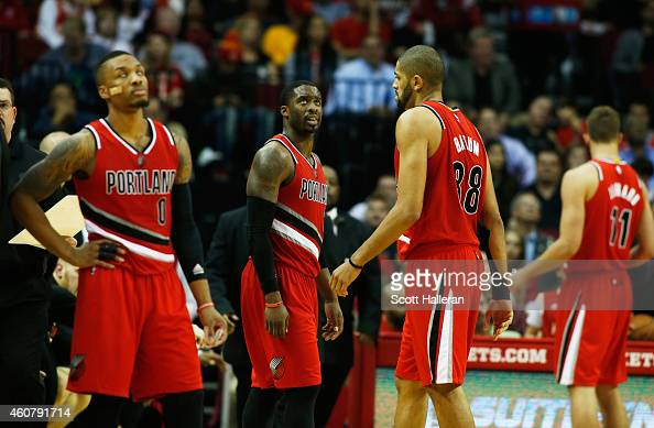 Damian Lillard Wesley Matthews Nicolas Batum and Meyers Leonard of the Portland Trail Blazers wait on the court as a play is reviewed during their...