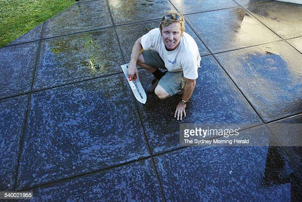 Damian Loveday of South Side Concreting with an example of the spray on concrete for a backyard outdoor area 15 June 2006 SMH picture by NARELLE AUTIO