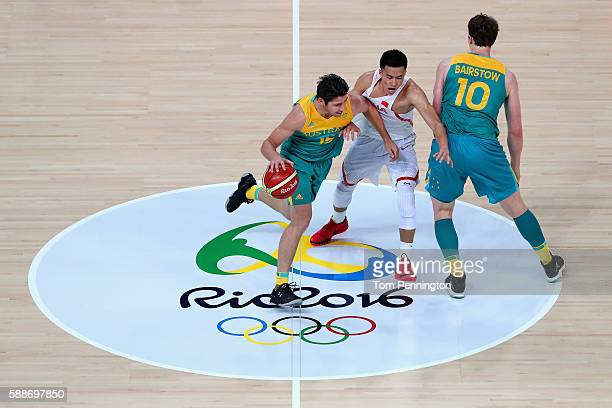 Damian Martin of Australia moves the ball against Ailun Guo of China during the Men's Basketball Preliminary Round Group A China vs Australia on Day...