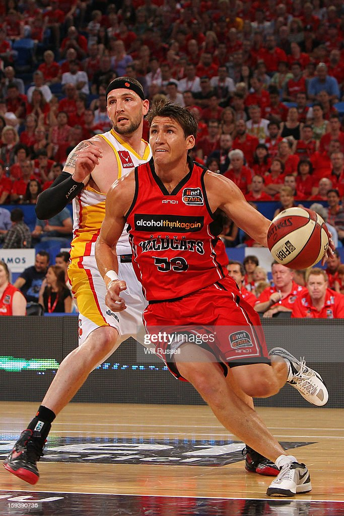 <a gi-track='captionPersonalityLinkClicked' href=/galleries/search?phrase=Damian+Martin+-+Basketball+Player&family=editorial&specificpeople=13687064 ng-click='$event.stopPropagation()'>Damian Martin</a> of the Wildcats brings the ball up the court during the round 14 NBL match between the Perth Wildcats and the Melbourne Tigers at Perth Arena on January 13, 2013 in Perth, Australia.