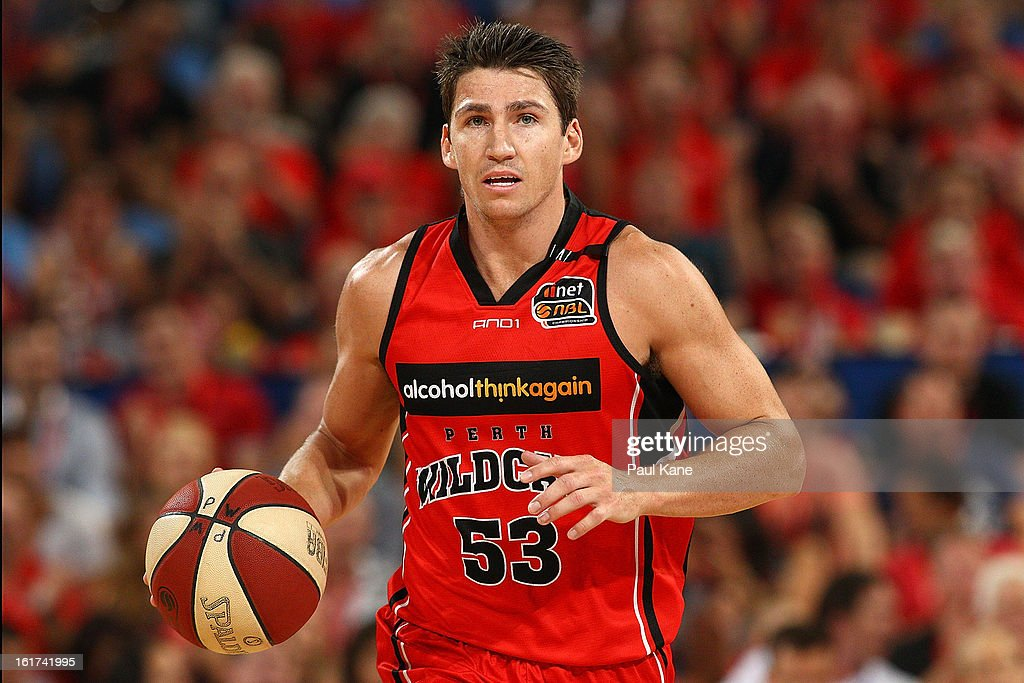 <a gi-track='captionPersonalityLinkClicked' href=/galleries/search?phrase=Damian+Martin+-+Basketball+Player&family=editorial&specificpeople=13687064 ng-click='$event.stopPropagation()'>Damian Martin</a> of the Wildcats brings the ball up the court during the round 19 NBL match between the Perth Wildcats and the Townsville Crocodiles at Perth Arena on February 15, 2013 in Perth, Australia.