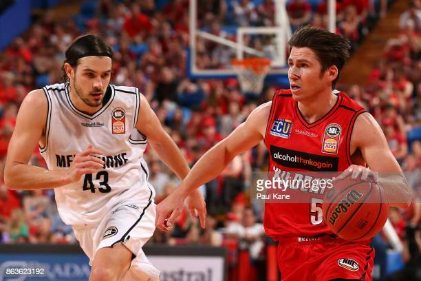Damian Martin of the Wildcats controls the ball against Chris Goulding of United during the round three NBL match between the Perth Wildcats and...