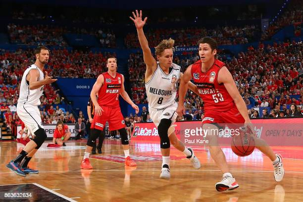 Damian Martin of the Wildcats controls the ball against Kyle Adnam of United during the round three NBL match between the Perth Wildcats and...