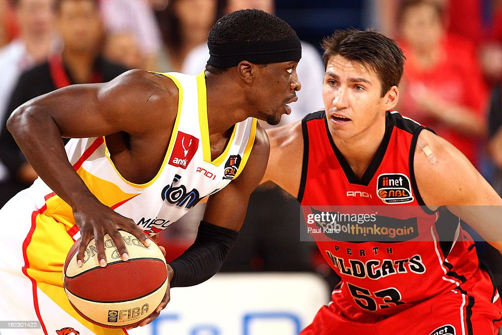Damian Martin of the Wildcats defends Jonny Flynn of the Tigers during the round 20 NBL match between the Perth Wildcats and the Melbourne Tigers at Perth Arena on February 21, 2013 in Perth, Australia.