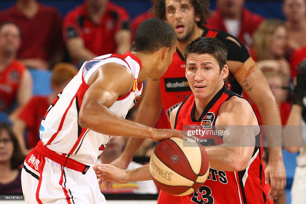 <a gi-track='captionPersonalityLinkClicked' href=/galleries/search?phrase=Damian+Martin+-+Basketball+Player&family=editorial&specificpeople=13687064 ng-click='$event.stopPropagation()'>Damian Martin</a> of the Wildcats defends on Adris DeLeon of the Hawks during game one of the NBL Semi Final Series between the Perth Wildcats and the Wollongong Hawks at Perth Arena on March 28, 2013 in Perth, Australia.