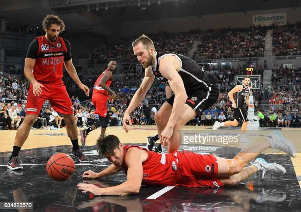 Damian Martin of the Wildcats dives for a ball during the round 19 NBL match between Melbourne United and the Perth Wildcats at Hisense Arena on...