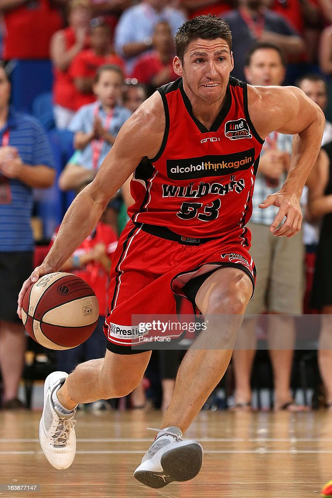 Damian Martin of the Wildcats drives to the key during the round 23 NBL match between the Perth Wildcats and the Cairns Taipans at Perth Arena on March 17, 2013 in Perth, Australia.