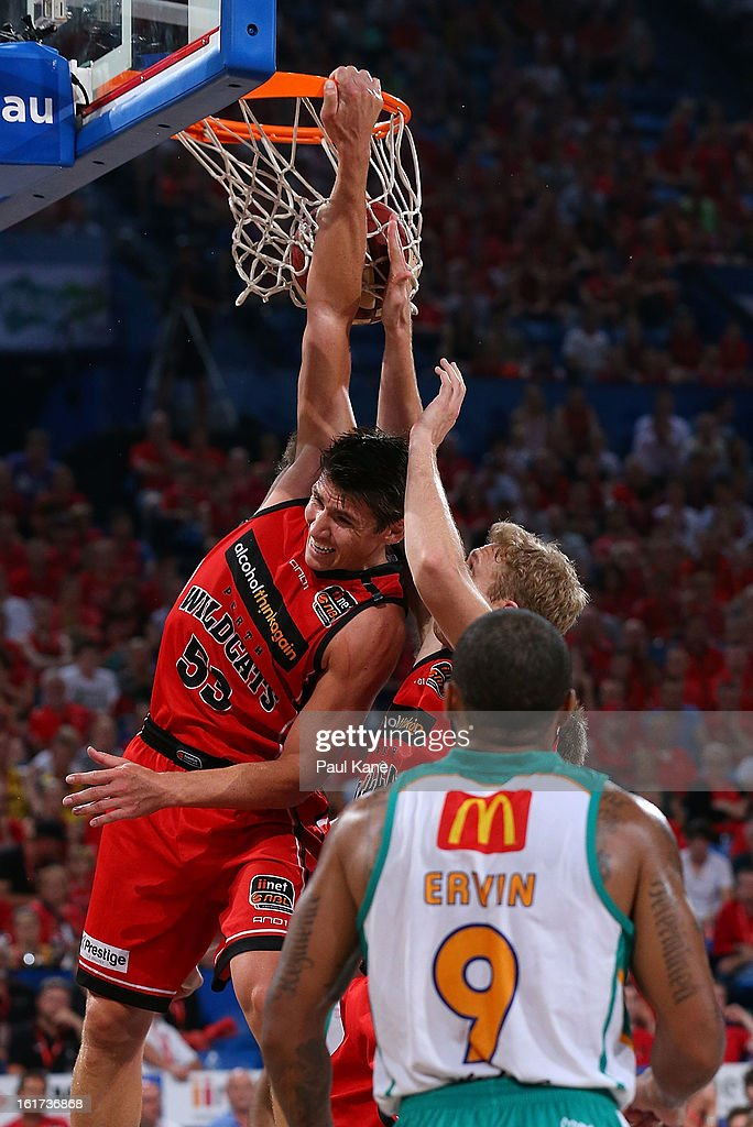 Damian Martin of the Wildcats dunks the ball during the round 19 NBL match between the Perth Wildcats and the Townsville Crocodiles at Perth Arena on February 15, 2013 in Perth, Australia.