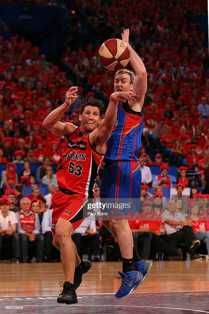 <a gi-track='captionPersonalityLinkClicked' href=/galleries/search?phrase=Damian+Martin+-+Basketball+Player&family=editorial&specificpeople=13687064 ng-click='$event.stopPropagation()'>Damian Martin</a> of the Wildcats passes the ball against Brendan Teys of the 36ers during game one of the NBL Grand Final series between the Perth Wildcats and the Adelaide 36ers at Perth Arena on April 7, 2014 in Perth, Australia.
