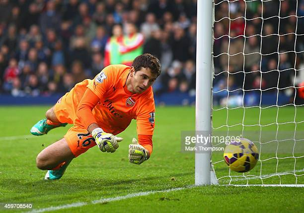 Damian Martínez of Arsenal makes a save during the Barclays Premier League match between West Bromwich Albion and Arsenal at The Hawthorns on...
