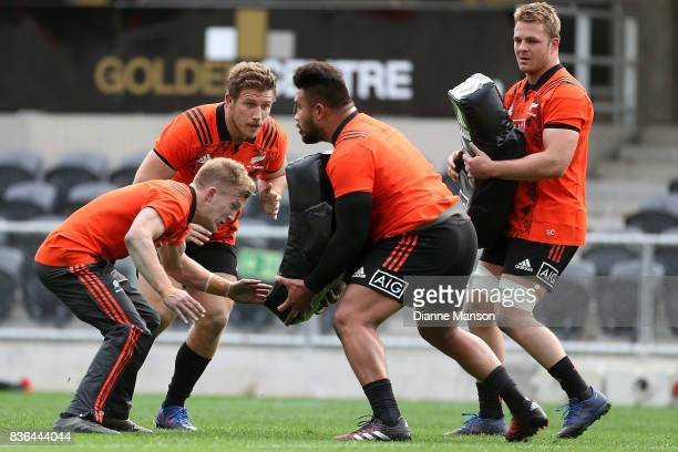 Damian McKenzie and Nathan Harris of the All Blacks Atunaisa Moli during a New Zealand All Blacks Training Session on August 22 2017 in Dunedin New...