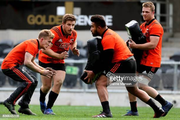Damian McKenzie and Nathan Harris of the All Blacks look to tackle Atunaisa Moli as Sam Cane looks on during a New Zealand All Blacks Training...