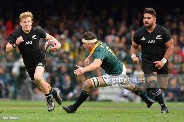 Damian McKenzie of New Zealand and Francois Louw of South Africa during the Rugby Championship 2017 match between South Africa and New Zealand at DHL...