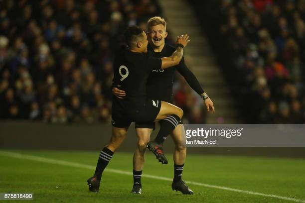 Damian McKenzie of New Zealand celebrates with Aaron Smith of New Zealand after he scores his teams second try during the International test match...