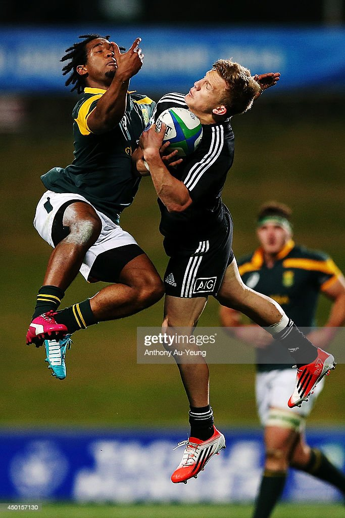 Damian McKenzie of New Zealand competes for the high ball against <a gi-track='captionPersonalityLinkClicked' href=/galleries/search?phrase=Sergeal+Petersen&family=editorial&specificpeople=10508841 ng-click='$event.stopPropagation()'>Sergeal Petersen</a> of South Africa during the 2014 Junior World Championships match between New Zealand and South Africa at QBE Stadium on June 6, 2014 in Auckland, New Zealand.