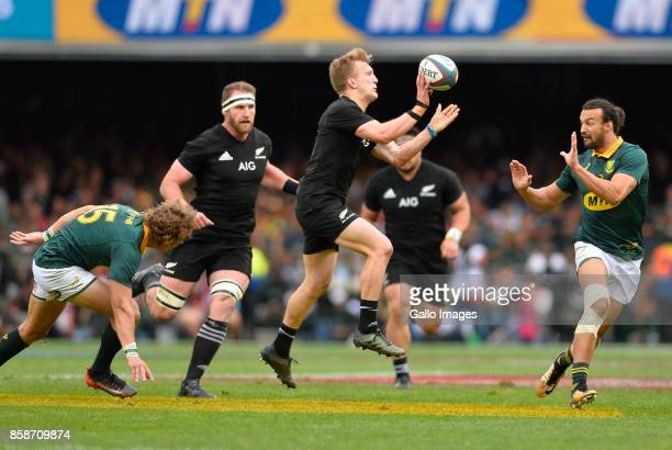 Damian McKenzie of New Zealand offloads the ball during the Rugby Championship 2017 match between South Africa and New Zealand at DHL Newlands on...