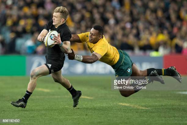 Damian McKenzie of the All Blacks gets tackled by Australia's Tevita Kuridrani during The Rugby Championship Bledisloe Cup match between the...