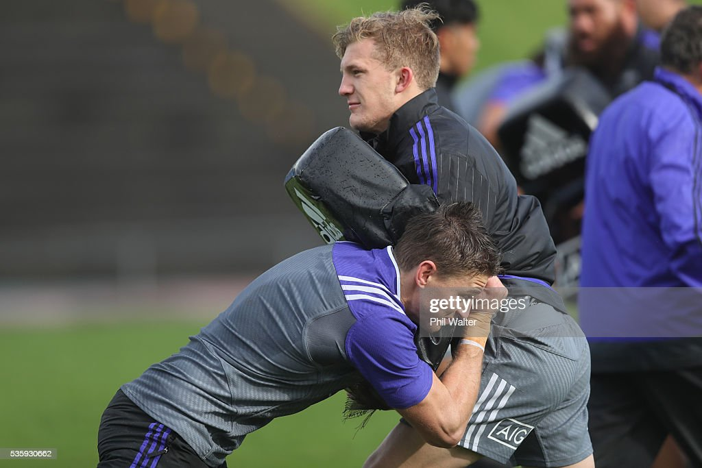 Damian McKenzie of the All Blacks is tackled by <a gi-track='captionPersonalityLinkClicked' href=/galleries/search?phrase=Beauden+Barrett&family=editorial&specificpeople=7264286 ng-click='$event.stopPropagation()'>Beauden Barrett</a> during a New Zealand All Blacks training session at Trusts Stadium on May 31, 2016 in Auckland, New Zealand.