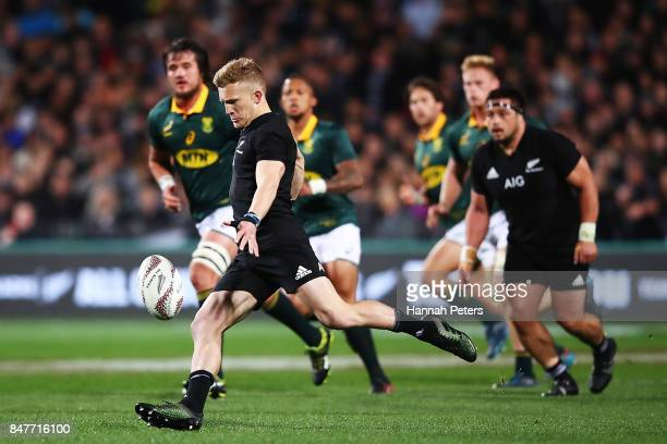 Damian McKenzie of the All Blacks kicks the ball through during the Rugby Championship match between the New Zealand All Blacks and the South African...