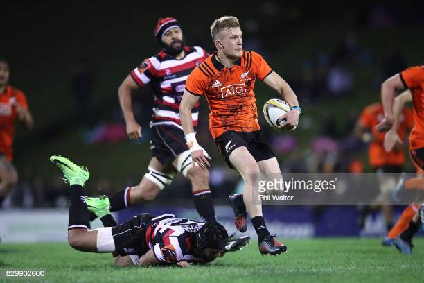 Damian McKenzie of the All Blacks makes a break during the Game of Three Halves between the All Blacks and Counties at ECOLight Stadium on August 11...