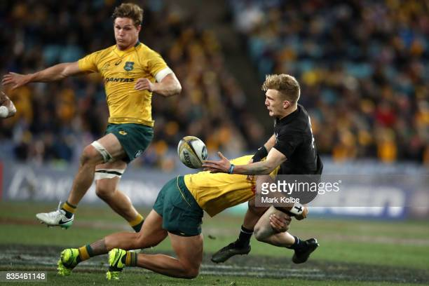 Damian McKenzie of the All Blacks passes as he is tackled during The Rugby Championship Bledisloe Cup match between the Australian Wallabies and the...