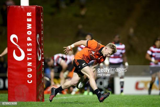 Damian McKenzie of the All Blacks scores a try during the Game of Three Halves between the All Blacks and Counties at ECOLight Stadium on August 11...