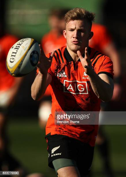 Damian McKenzie of the All Blacks takes a pass during a New Zealand All Blacks training session at North Sydney Oval on August 17 2017 in Sydney...