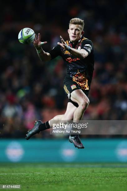 Damian McKenzie of the Chiefs catches a pass during the round 17 Super Rugby match between the Chiefs and the Brumbies at Waikato Stadium on July 15...