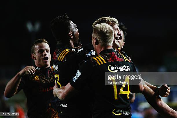 Damian McKenzie of the Chiefs celebrates after scoring a try during the round five Super Rugby match between the Chiefs and the Western Force at FMG...