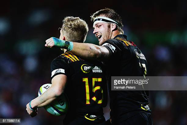 Damian McKenzie of the Chiefs celebrates with Sam Cane of the Chiefs after scoring a try during the round five Super Rugby match between the Chiefs...