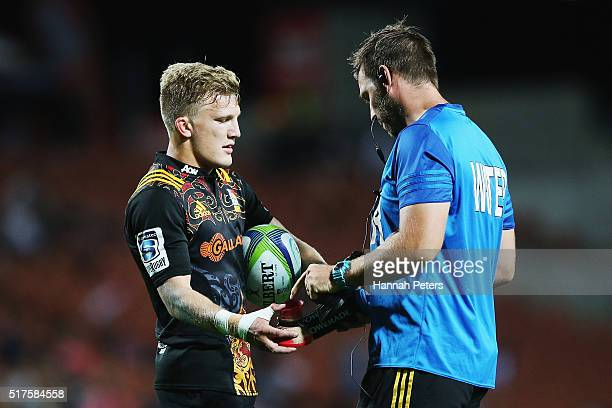 Damian McKenzie of the Chiefs collects his kicking tee during the round five Super Rugby match between the Chiefs and the Western Force at FMG...