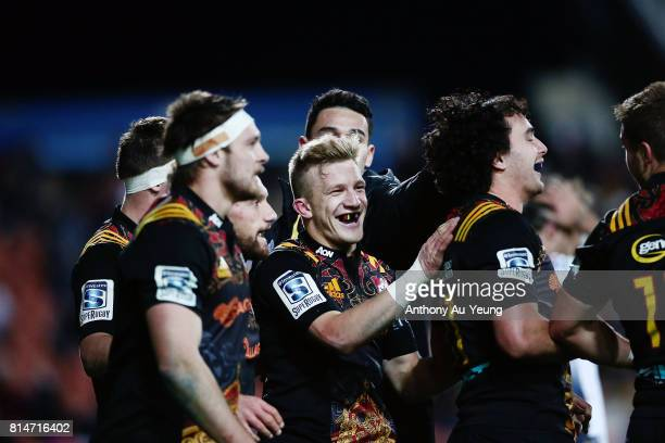 Damian McKenzie of the Chiefs congratulates teammate James Lowe on his try later ruled disallowed during the round 17 Super Rugby match between the...