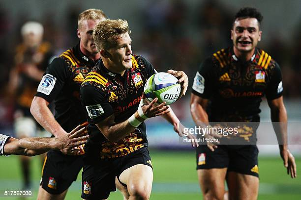 Damian McKenzie of the Chiefs dives ober to score a try during the round five Super Rugby match between the Chiefs and the Western Force at FMG...