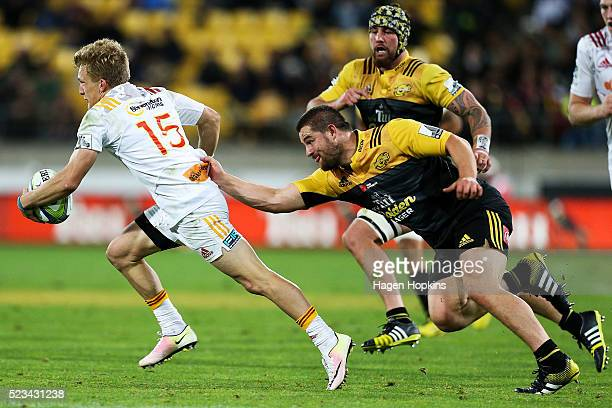 Damian McKenzie of the Chiefs is caught by Dane Coles of the Hurricanes during the round nine Super Rugby match between the Hurricanes and the Chiefs...
