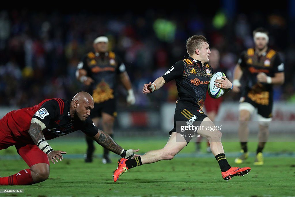 Damian McKenzie of the Chiefs is tackled by <a gi-track='captionPersonalityLinkClicked' href=/galleries/search?phrase=Nemani+Nadolo&family=editorial&specificpeople=6547098 ng-click='$event.stopPropagation()'>Nemani Nadolo</a> of the Crusaders during the round 15 Super Rugby match between the Chiefs and the Crusaders at ANZ Stadium on July 1, 2016 in Suva, Fiji.