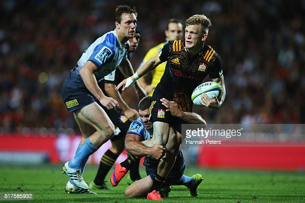 Damian McKenzie of the Chiefs makes a break during the round five Super Rugby match between the Chiefs and the Western Force at FMG Stadium on March...
