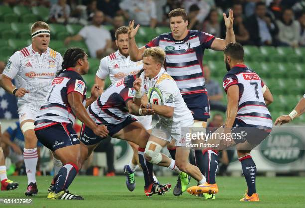 Damian McKenzie of the Chiefs runs with the ball during the round four Super Rugby match between the Rebels and the Chiefs at AAMI Park on March 17...
