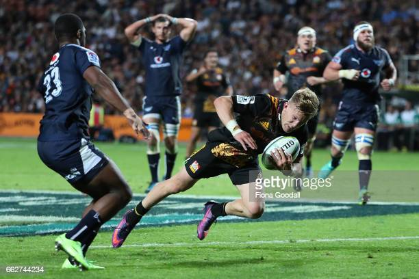 Damian McKenzie of the Chiefs scores a try during the round six Super Rugby match between the Chiefs and the Bulls at Waikato Stadium on April 1 2017...