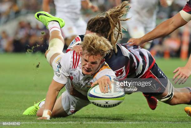Damian McKenzie of the Chiefs scores a try which was later disallowed during the round four Super Rugby match between the Rebels and the Chiefs at...