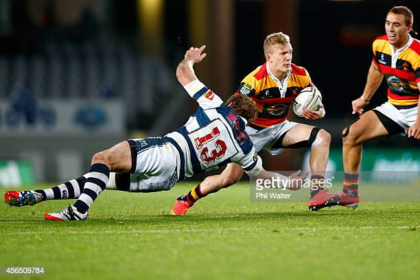 Damian McKenzie of Waikato is tackled by Hadleigh Parkes of Auckland during the ITM Cup match between Auckland and Waikato at Eden Park on October 2...