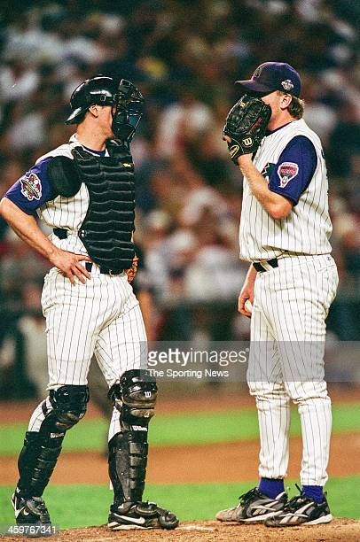 Damian Miller and Curt Schilling of the Arizona Diamondbacks talk on the mound during Game One of the World Series against the New York Yankees on...