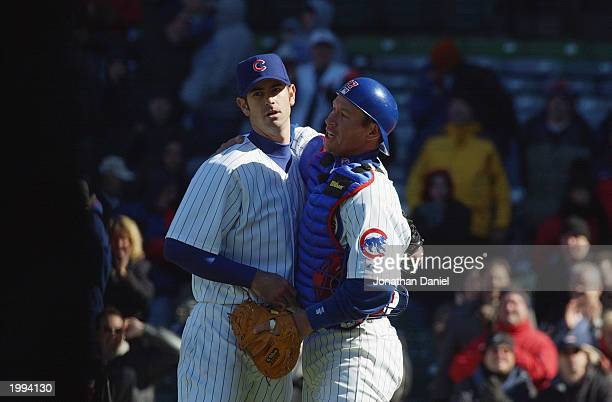 Damian Miller of the Chicago Cubs hugs pitcher Mark Prior after Prior recorded his first career shutout during the game against the Montreal Expos at...