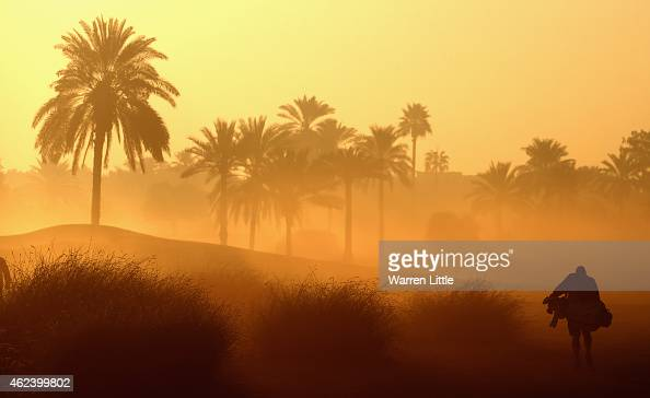 Damian Moore caddie to Stephen Gallacher walks up the 10th fairway during the proam ahead of the Omega Dubai Desert Classic on the Majlis Course at...