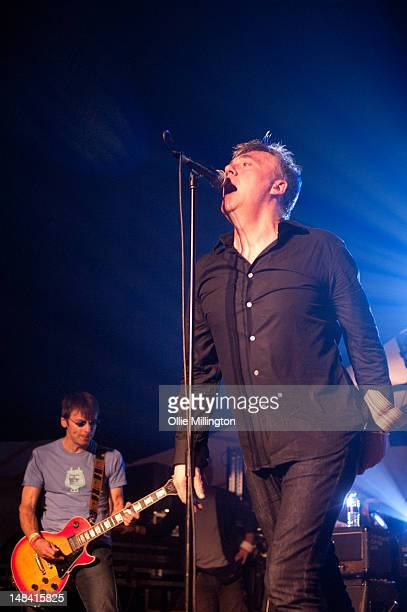 Damian O'Neill and Paul McLoone of The Undertones perform on stage during Guilfest at Stoke Park on July 15 2012 in Guildford United Kingdom
