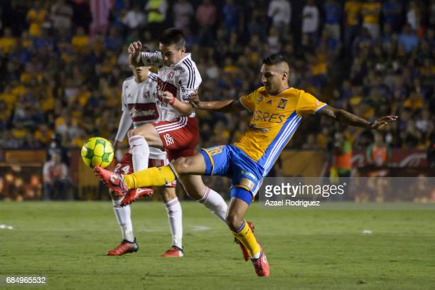 Damian Perez of Tijuana fights for the ball with Ismael Sosa of Tigres during the semi finals first leg match between Tigres UANL and Tijuana as part...